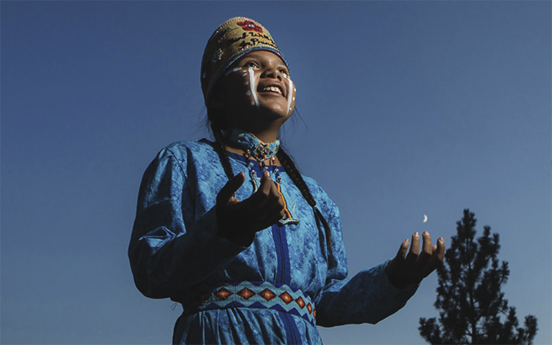 young indigenous girl at ceremony