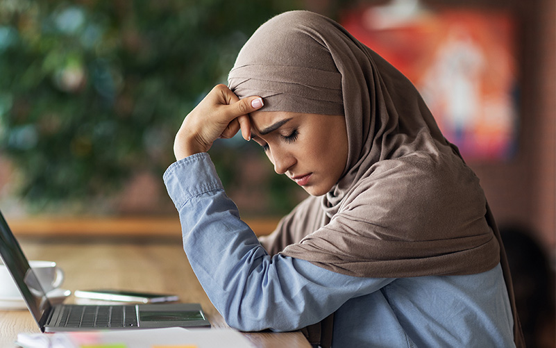 young muslim woman looking downcast